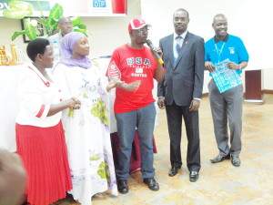 Moses Super Charger (in red t-shirt) who has been living with HIV/AIDS for over 20 years giving his acknowledgement speech after he was recognised for his role in fighting HIV/AIDS.